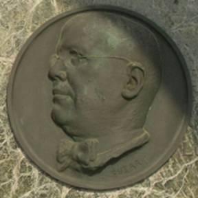 Guerrisi – Basso rilievo funebre di Conti Cav. Alfredo, Cimitero di Luzzara.